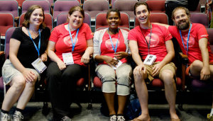The WordCamp Montreal 2015 Organizers all sitting together in the first row of an auditorium